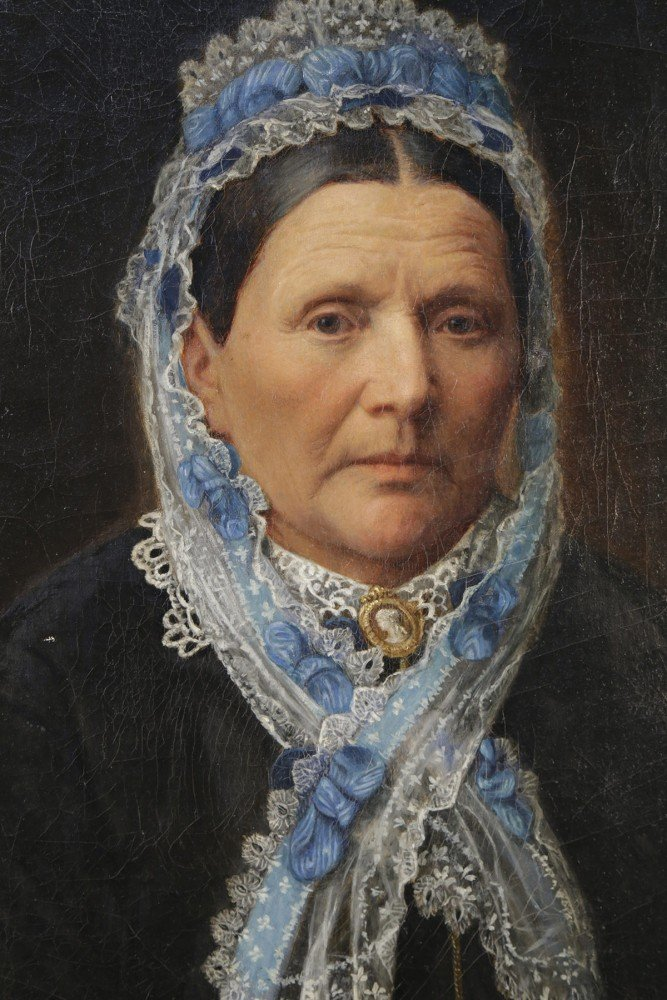 19th Century American Portrait of a Woman in a Lace Bonnet with a Blue Ribbon by 19th Century American School