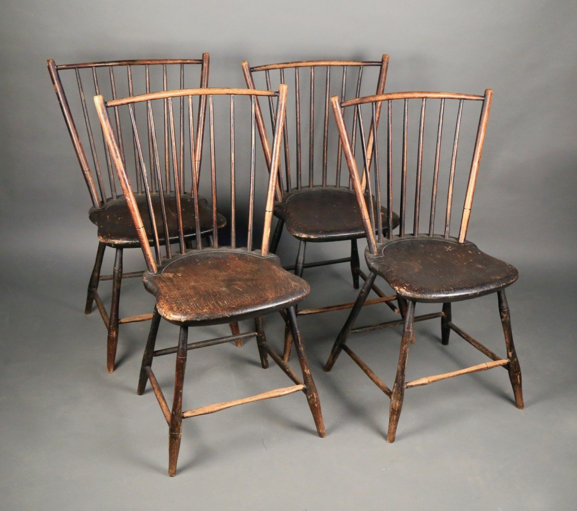 Four Black Painted Primitive Windsor Side Chairs, late 18thc.