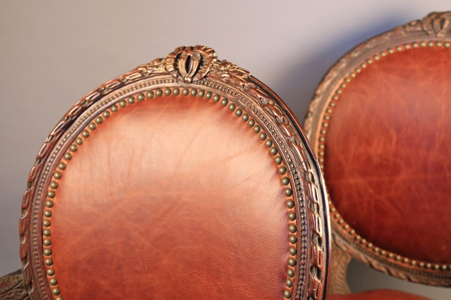 Pair of Louis XVIth Style Leather Upholstered Open Armchairs