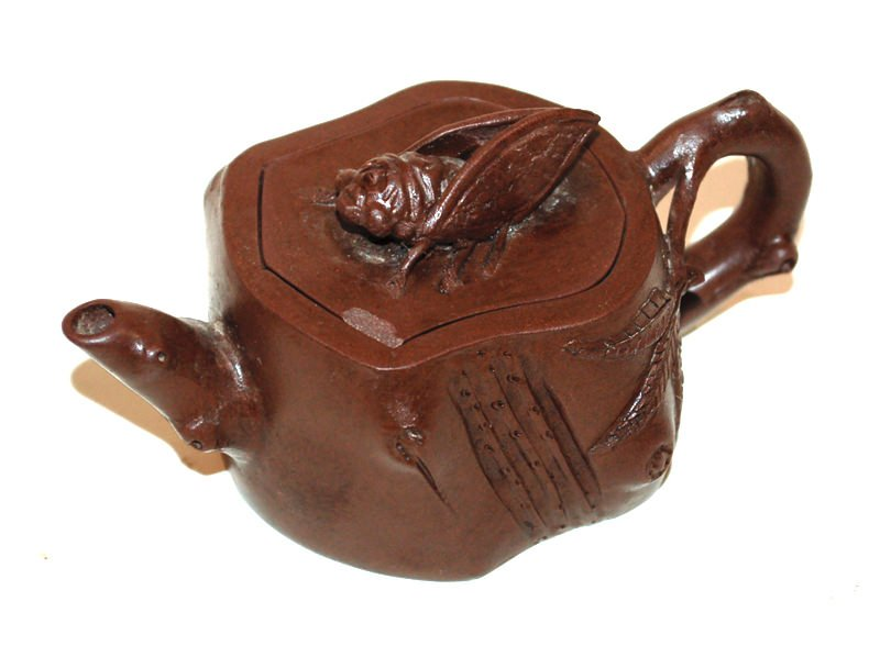 A Chinese Yi Xing Teapot With Cicada Finial