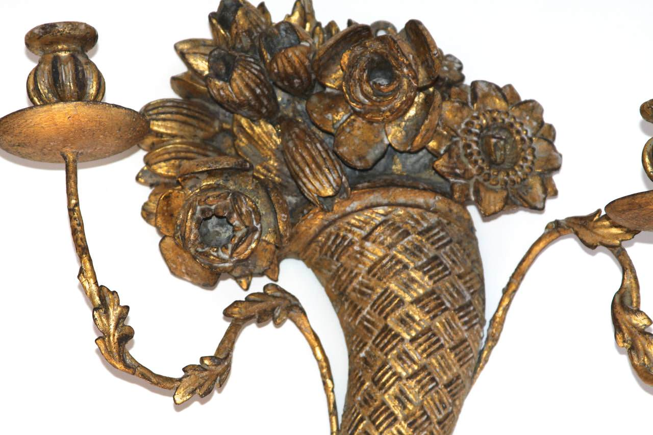 A Pair of Continental Carved and Gilded Wood Two Light Cornucopia Sconces