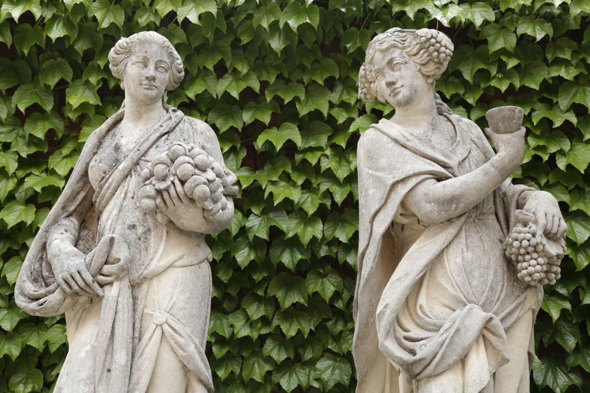 An impressive monumental group of four French handcarved limestone garden figures depicting the seasons