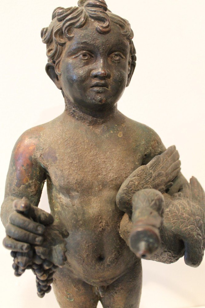 A Grand Tour Bronze of a Boy Holding a Duck and a Bunch of Grapes