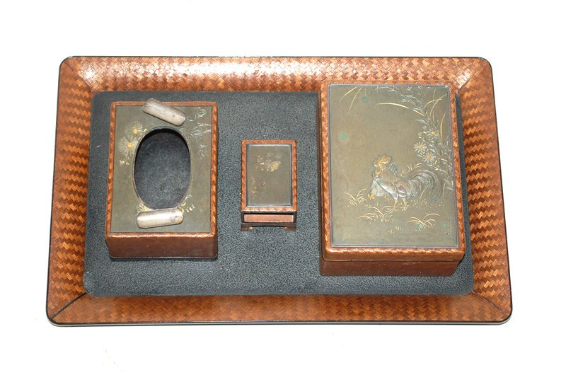 A Japanese Mixed Metal and Lacquered Wood Smoking Set