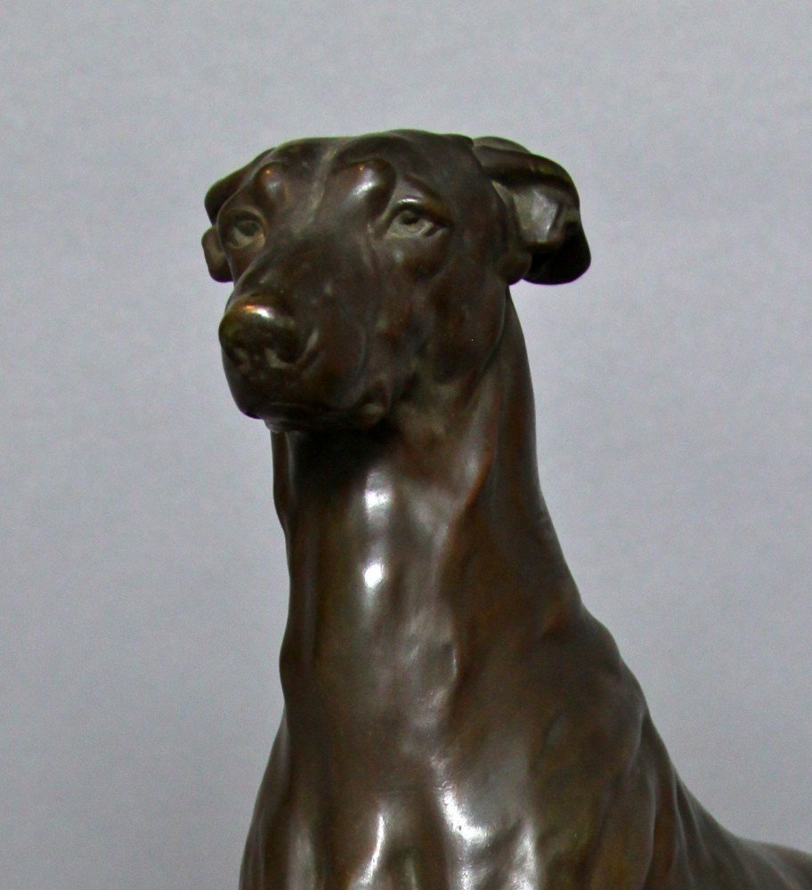 Animal Bronze with brownish green patination, on a fitted stone base Sculpture: