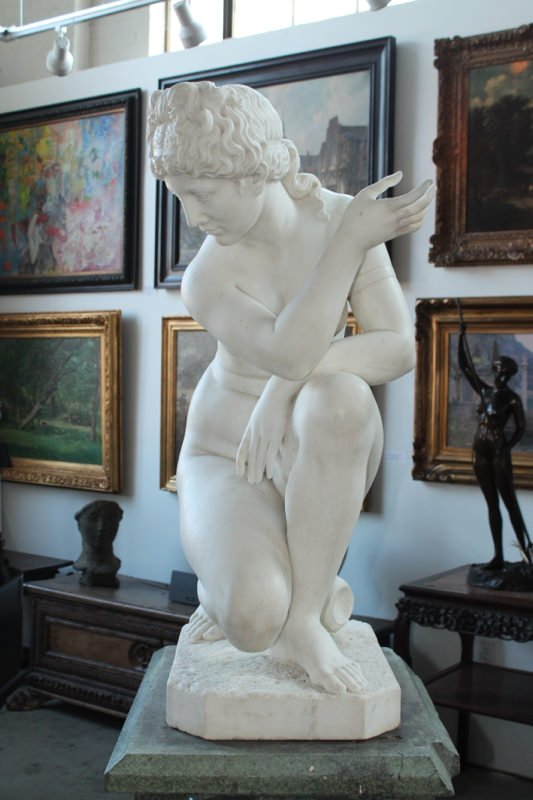 Figurative Marble on a beautifully carved and balanced verdigris revolving pedestal Sculpture: