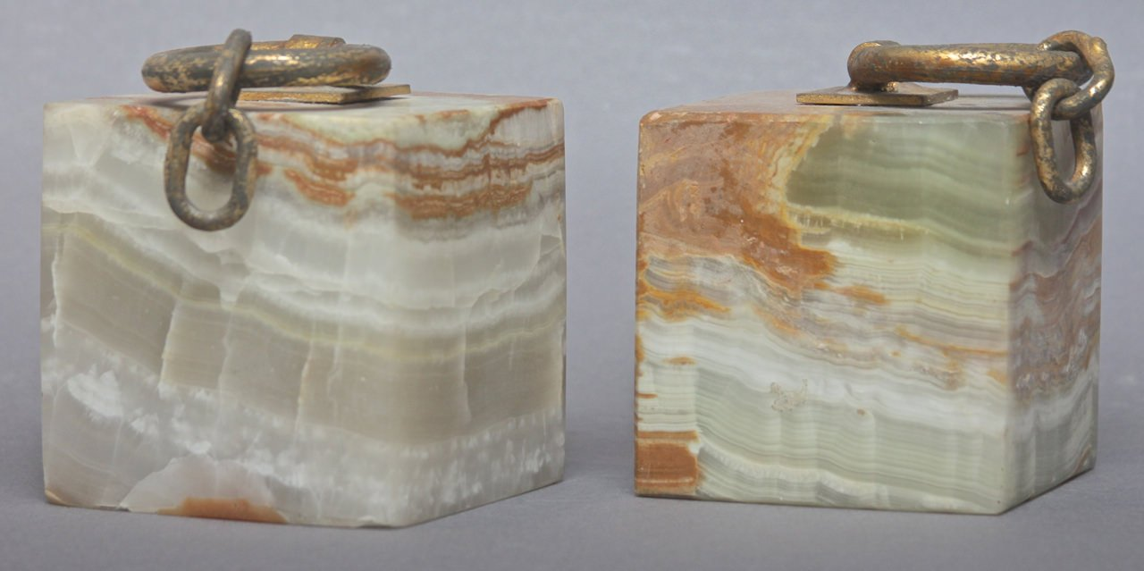 A Pair of Curtis Jere Onyx and Gilded Steel Bookends