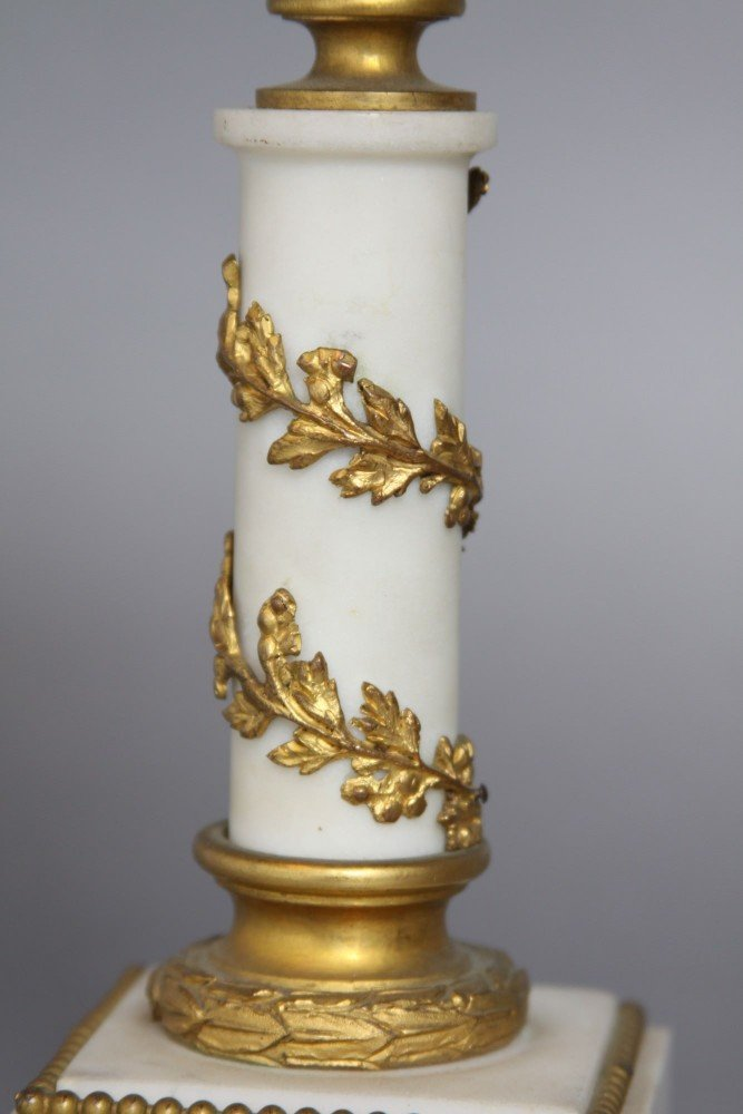 A Pair of French Gilt Bronze and Marble Candlesticks