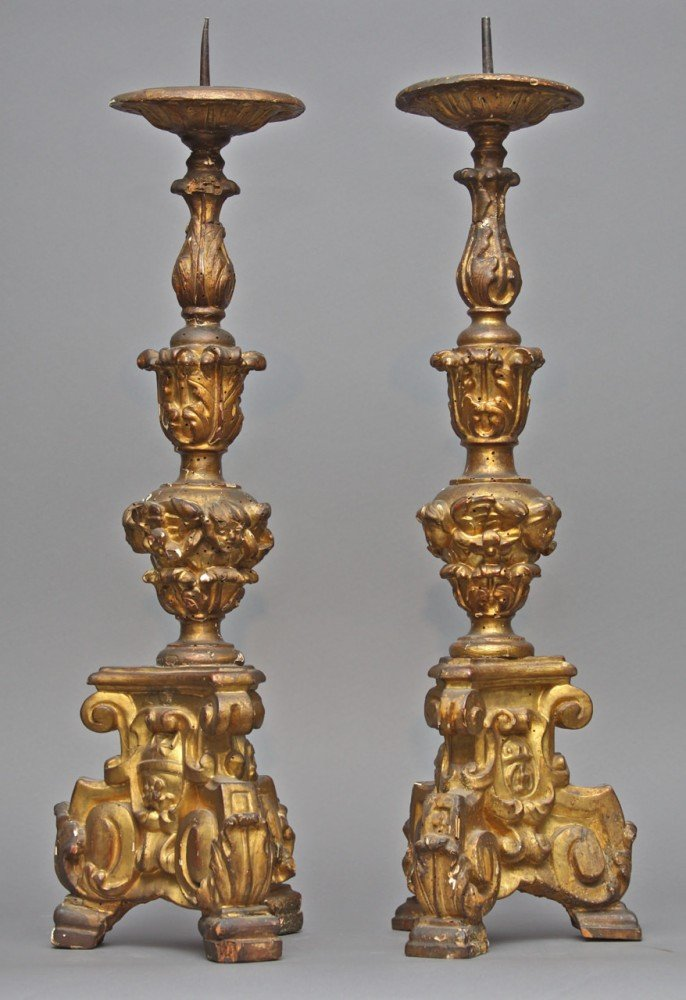 A Pair of Venetian Baroque Carved and Gilded Pricket Sticks