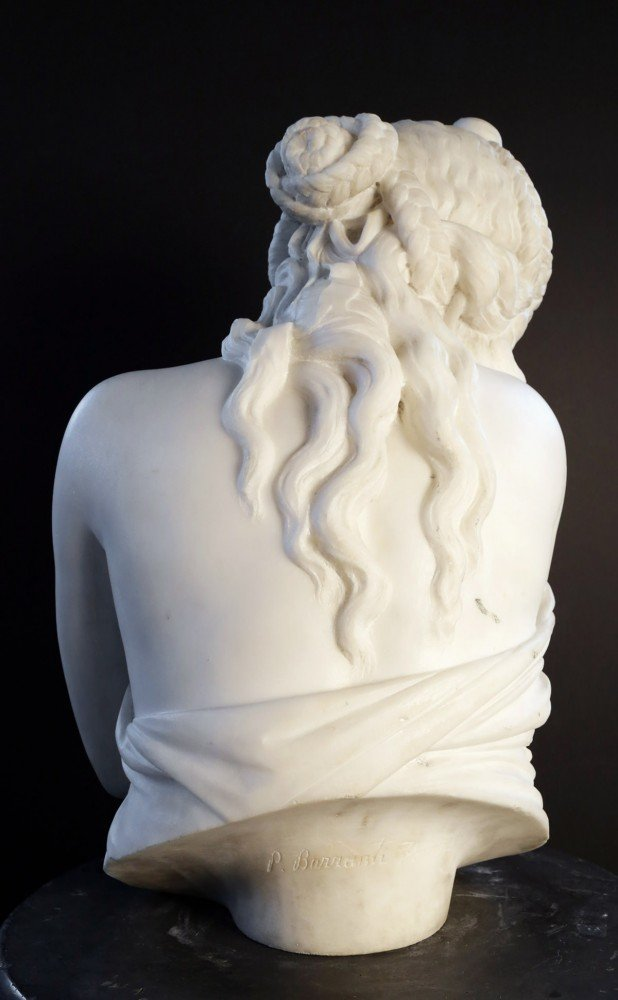 A Carved Marble Bust of a Demure Young Girl